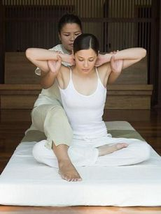 Young woman having a thai massage